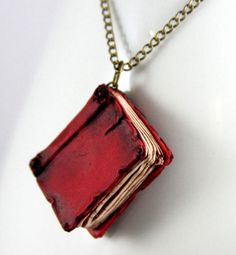 Red book necklace