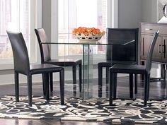 Give your dining room style savvy look with the Glass on Glass Square dining table.