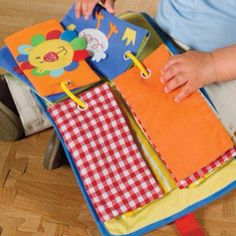 Fabric sensory book - may be a way to make this easily and put on a ring
