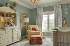 Traditional nursery by McCroskey Interiors. Wall color: Benjamin Moore James River Gray AC-23, Hard Furniture: Muniere, Rug & Hanging Balloon: Pottery Barn Kids, Custom Draperies in Jane Churchill Fabric in Solano Blue. ceiling is paint color cut by half