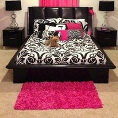 Black and pink bedroom!  Notice how just adding a little rug on the floor adds an accent color too.