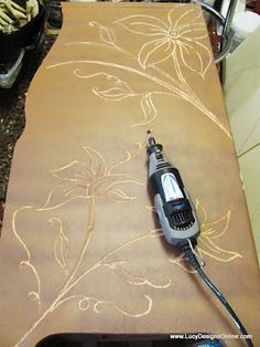 Using a dremel to carve designs into wooden furniture that is already scuffed or damaged that you find for cheap at thrift or yard sale!