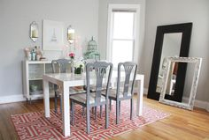 Editor @Alaina Kaczmarski's Home Tour // @west elm white parsons dining table // RugsUSA geometric pink rug // grey dining chairs // birdcage // grey walls