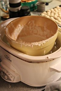 Chocolate Dipping Tip: Take a large Crock Pot and fill it about half way with hot water.  Turn the Crock Pot on high to keep the water hot.  Find a smaller bowl that will fit into the crock pot. Melt your chocolate in the microwave and transfer it to the inner bowl.  This method will keep your chocolate nice and melted for you while you coat.