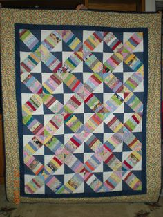 Bonnie Hunter's String-X pattern - machine pieced and hand quilted.