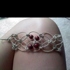 Thick knot bracelet made with hemp and beads.