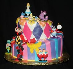 I like the Disney characters on this cake, especially the Cheshire cat because he's my favorite.