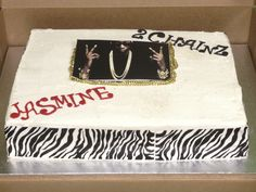 A vanilla cake filled with fresh strawberries pleased this teens birthday request for a 2 CHAINZ themed cake!