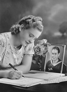 A heartwarmingly lovely photo of a young woman writing to her sailor. #vintage #1940s #WW2 #homefront