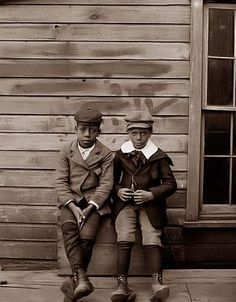 """You are looking at an educational picture of Clarence """"Grandpa"""" Liv and Alonzo """"Teddy"""" Tucker behind the Wright Cycle Company. The picture was taken by Orville and Wilbur Wright."""