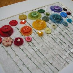 "Young Women, KNOWLEDGE: Learn to sew on a button and embroider at the same time. ""Button flower garden"". Would be a great project for the girls."