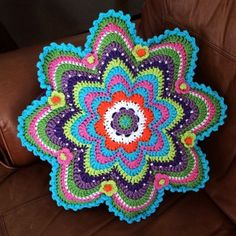 Beautiful colorful #crochet cushion by @caswelljones