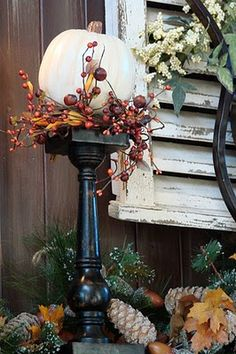 Autumn decor; white pumpkin with black stand