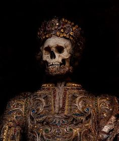 Jeweled skeleton from the 1600s'Taken from the catacombs of Rome in the 17th century, the relics of twelve martyred saints were then attired in the regalia of the period before being interred in a remote church on the German/Czech border.'  - Immortal, Toby de Silva