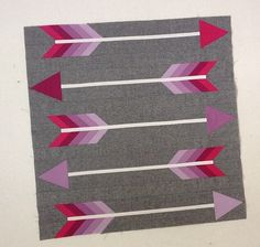 Arrow quilt block. This looks fantastic. More and more people are using grey backgrounds instead of white.