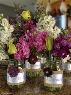 Easy Mason Jar Centerpieces- Come see how easy it is to make these gorgeous vases for table centerpieces, gifts & home decor. http://frugelegance.com/post/82898588160/easy-diy-mason-jar-vases #MasonJar #MasonJarVase #DIY #DIYVase #FlowerCenterpiece #MasonJarCrafts
