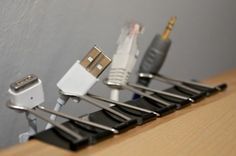 cheap easy way of organizing charger cords. I just did this on the edge of my desk.