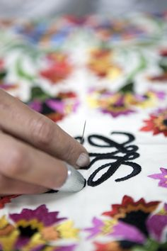 A technique of double-embroidery is used in the centre area of the shawl. This way the patterns are more distinct.