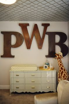 Oversized initial letters make a huge statement in the nursery. (Plus, how fab is that painted glossy dresser?!)