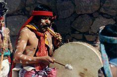 A Tarahumara Indian man playing a hoop drum.  store.southwestin...
