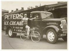 Hubert Opperman eating an ice cream next to a Peter's Ice Cream Reo truck,1936, Australia. by Sam Hood