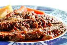 <3 Classic Swiss steak, inch-thick round steak browned and then slow cooked in a sauce of tomatoes, onion, garlic and herbs.