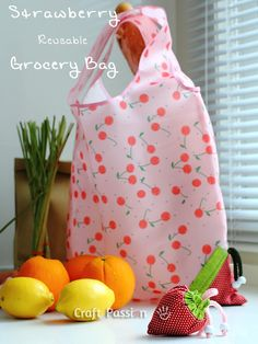 Sew a reusable grocery bag that cinches up into a cute strawberry carrying bag.  AWESOME!!