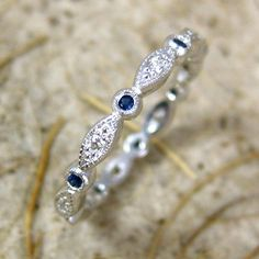 round - oval diamond and sapphire wedding band. Love this.