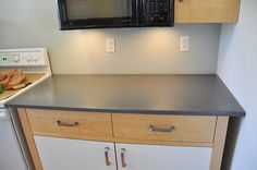 Painting current countertops (Rust-oleum's Countertop Coating) would give me a chance to save up for some yummy NEW countertops. $20