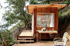 Okay - I could live here! I REALLY like the idea of the outdoors sink, food prep area.  Maybe I am going to have to find a way to rig up similar at my little cabin(it does not have plumbing - I would need to gravity feed the water. #cabin #woods #housing