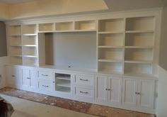 built in design for the living room. book shelves and a counter