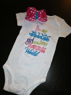 I'm my daddys girl and my mommys world onesie and shirt with bow. $24.00, via Etsy.