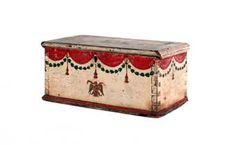 MINIATURE PAINTED PINE BLANKET CHEST, 19th c., with swag over a spread wing eagle