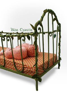 Antique baby bed  covered in crochet with Apple's cushions and sheet ...