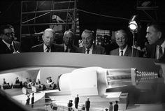 """Walt Disney viewing a model for the """"Adventure Through Inner Space"""" attraction at Disneyland. About 1966."""