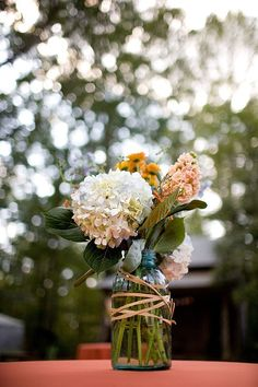 simple bouquet in a mason jar tied with twine