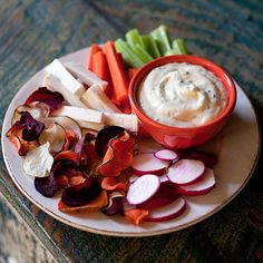 Dunk root vegetable chips and sliced veggies in our creamy homemade ranch dip. Use mayonnaise or Greek yogurt as the base. #snack