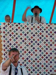 Amish Quilt Auction. Cathedral Windows Quilt.