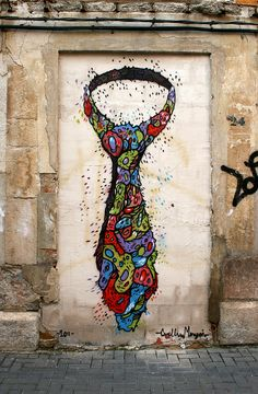 Cuellimangui is a street artist mostly active around Spain. While his style could be compared to Horfe and Mark Dean Veca, I think Cuellimangui has taken Veca's influence and made a visual vocabulary all his own.