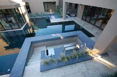 Infinity pools are the coolest yet.  Plus, that mostly glassed-in room to the left would be great for a writing studio!