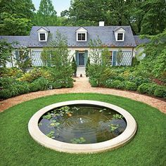 Reflecting Pool | Water lilies, lotuses, underwater anacharis, and water hyacinths thrive in the 22-inch-deep reflecting pool, keeping the water cool while removing the nitrogen that the goldfish and frogs leave behind. | SouthernLiving.com