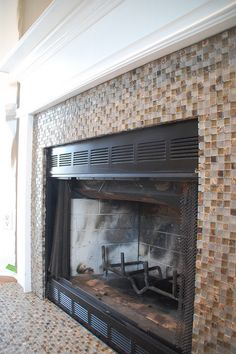 We are thinking about covering the ugly green marble tile with adhesive tiles.  This is a good example of how it could look.