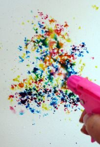 Fill the water gun with watercolors then shoot. YESSS