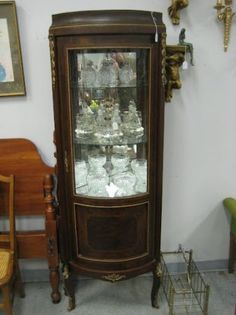 Corner Curio Cabinet  $450 - Fort Washington http://furnishly.com/catalog/product/view/id/1431/s/corner-curio-cabinet/