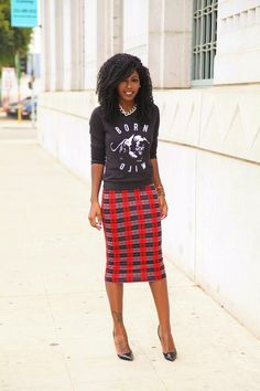 Super cute outfit! #fashion plaid skirt graphic sweater. Heels