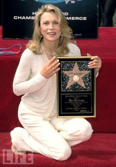 Faye and star on Hollywood Walk of Fame.