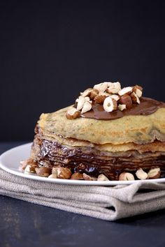 OH.MY: Nutella Crepe Cake    280 grams (about 2 cups) kumquat's all-purpose flour  70 grams (about 1/2 cup) hazelnut flour*  2  tbsp sugar  6  large eggs  2  cups milk  6  tbsp canola oil  1  tsp vanilla  1/4 tsp salt  Extra oil for brushing skillet  Nutella  Chopped hazelnuts to garnish    Combine flours, sugar, eggs, milk, 6 tablespoons canola oil, vanilla, and salt in a large measuring cup or bowl. Stir well with a wire whisk until smooth. Let stand for 15 minutes.