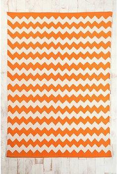 Orange zigzag rug for nursery