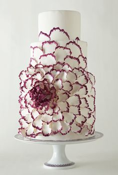 Brides.com: America's Most Beautiful Cakes. Why use lots of flowers when you can have one mega showstopper? That's what Miche Bacher and Nanao Anton thought after seeing a Yumi Katsura gown featuring a pretty peony.  Fondant cake with hand-painted sugar-dough petals, $20 per slice, Sacred Sweets, Greenport, NY; stand, Versace for Rosenthal