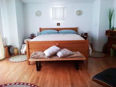 A customer photo sent in from Playa Del Rey, California! Our cherry wood essex bed makes the perfect centerpiece for this California cool bedroom. Our Metropolitan wood and metal coffee table accents the bed, being used below the footboard! Very unique and nicely designed.